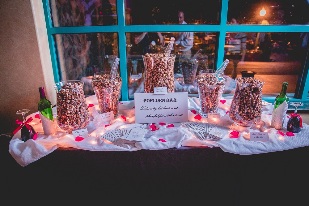 A popcorn bar is perfect for weddings, showers, birthdays, graduations, holiday celebrations, and business events. Select the flavors of your choice and we'll take care of supplies, set-up, and clean up OR use our delicious popcorn to create your own bar!